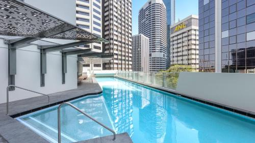 The swimming pool at or near Oaks Brisbane Aurora Suites