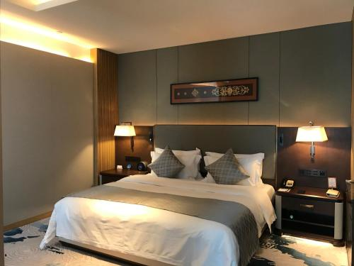 Dali International Hotelにあるベッド