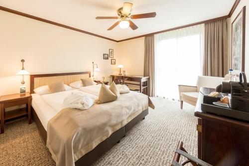 Ein Bett oder Betten in einem Zimmer der Unterkunft Maxx Hotel Jena