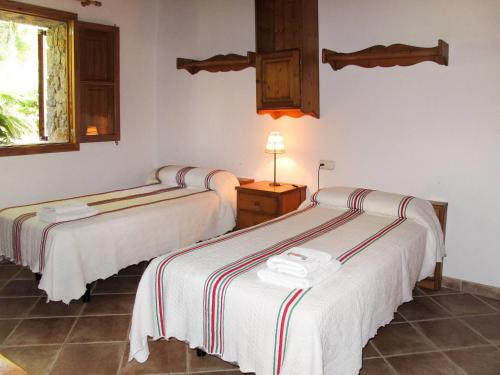 A bed or beds in a room at Holiday Home Casa Veleta - CPT170