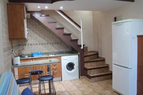 A kitchen or kitchenette at Bungalow Duna Flor Verde
