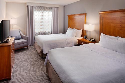 A bed or beds in a room at Homewood Suites by Hilton Portsmouth