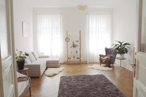 Area soggiorno di Janas Apartments