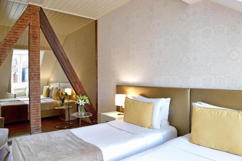 Ein Bett oder Betten in einem Zimmer der Unterkunft My Story Hotel Ouro