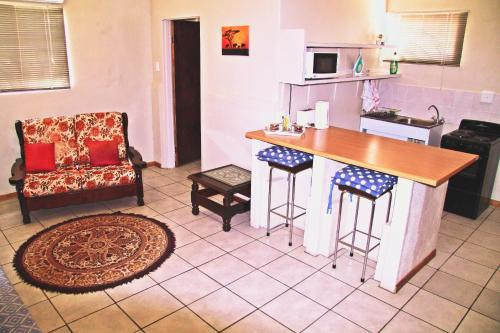A kitchen or kitchenette at Kaniklani Guest Apartments