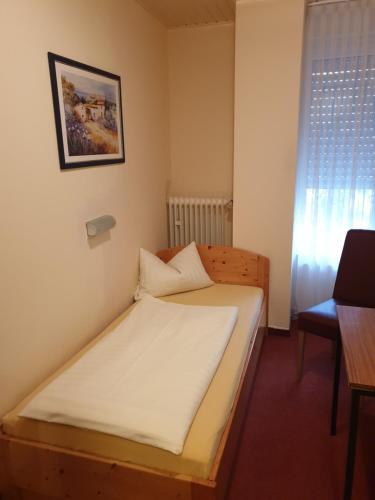 Postel nebo postele na pokoji v ubytování Hotel Giesing