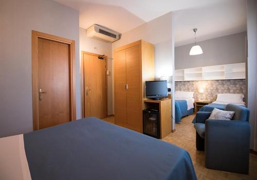 Letto o letti in una camera di Hotel Clarici