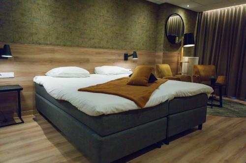 A bed or beds in a room at ´t Wapen van Marion