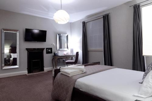 A bed or beds in a room at The City Rooms