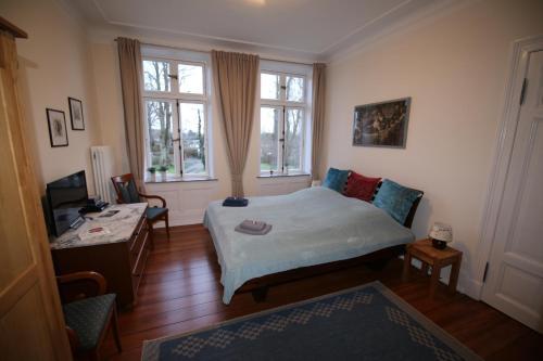 Ein Bett oder Betten in einem Zimmer der Unterkunft Herrenhaus Hohewarte