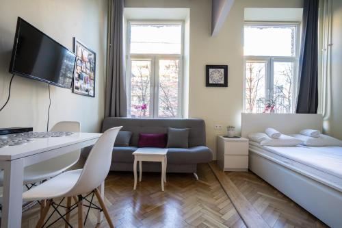 Telewizja i/lub zestaw kina domowego w obiekcie Elegant Apartment Copernicus