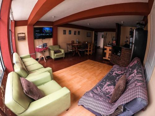 A seating area at Hostal Campo Base Huaraz