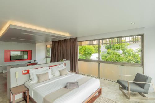 A bed or beds in a room at The COAST Adults Only Resort and Spa - Koh Phangan
