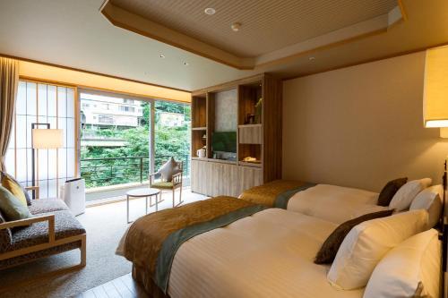 聚樂水上日式旅館房間的床