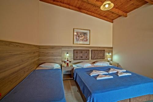 A bed or beds in a room at Blue Aegean Hotel & Suites