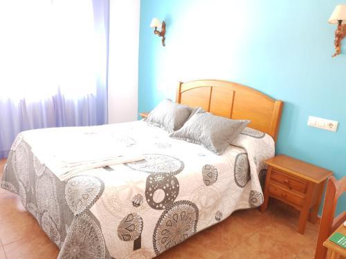 Cama o camas de una habitación en Hostal Río Mundo