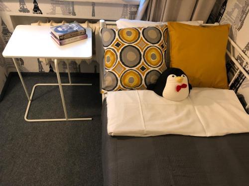 Кровать или кровати в номере Rooms 3 Penguins