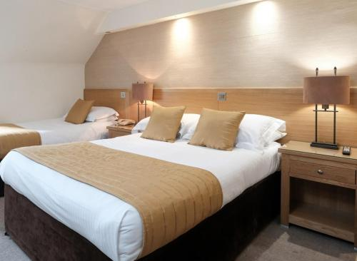 A bed or beds in a room at The City Hotel