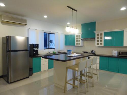A kitchen or kitchenette at Rimbun Suites & Residences