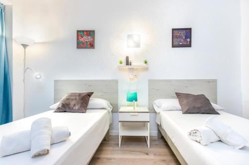 A bed or beds in a room at Hotel Boogaloo - Adults Only