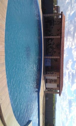 The swimming pool at or close to Espaço Encanto do Sertão