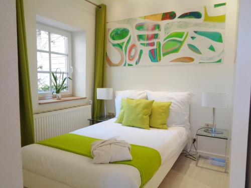 Ein Bett oder Betten in einem Zimmer der Unterkunft Hotel Apartment Puell