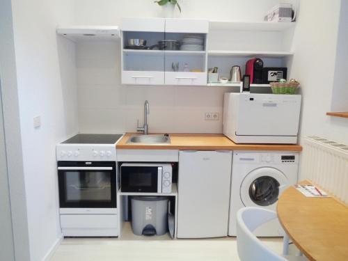 Küche/Küchenzeile in der Unterkunft Hotel Apartment Puell