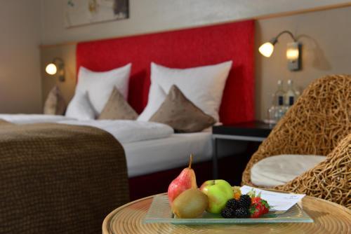 Ein Bett oder Betten in einem Zimmer der Unterkunft Parkhotel Weiskirchen