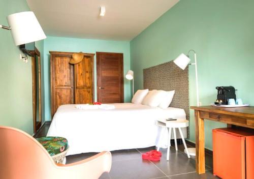 Cama ou camas em um quarto em Alojamiento Vacacional en Curacao