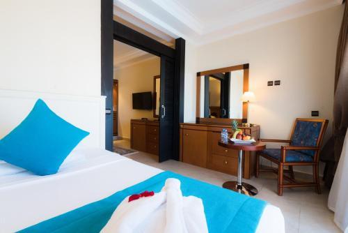Un ou plusieurs lits dans un hébergement de l'établissement Aqua Fun Club All inclusive