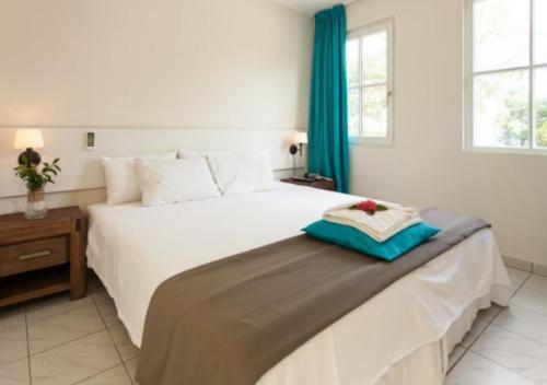 Cama ou camas em um quarto em Apartamento Vacacional con Terraza en Curacao