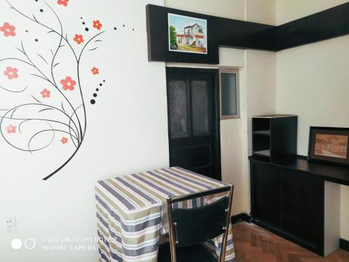 A television and/or entertainment center at Confortable 2