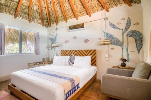 A bed or beds in a room at Selina Puerto Escondido
