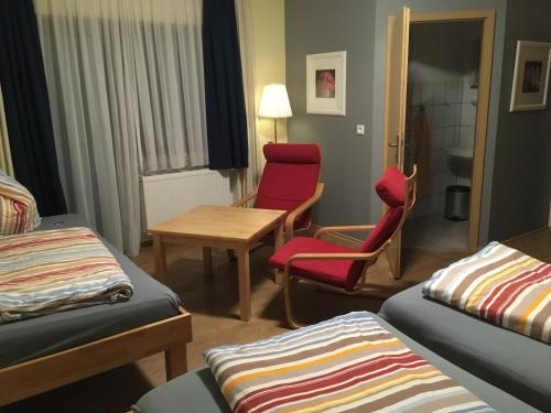 A bed or beds in a room at Pension Taunusblick Ferienwohnung und Apartment