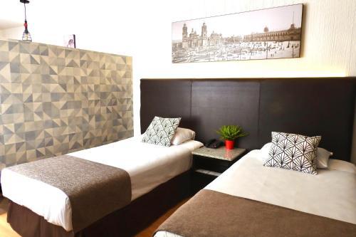 Cama o camas de una habitación en Suites Havre