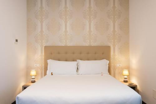 Letto o letti in una camera di Domus Porto Di Traiano Resort