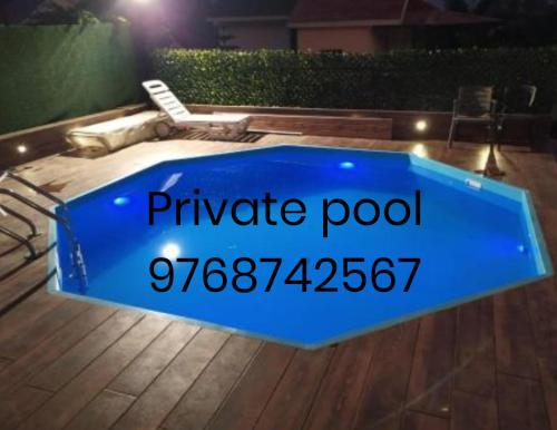 The swimming pool at or close to Ratan Villa