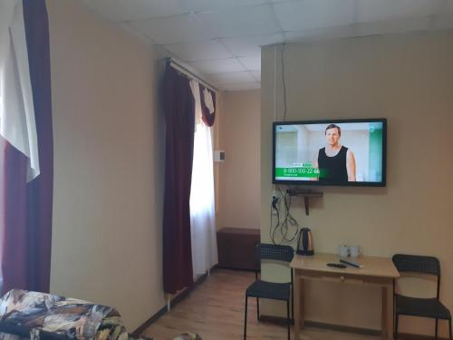 Телевизор и/или развлекательный центр в Отель Золотой Улей