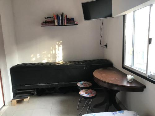 Una televisión o centro de entretenimiento en Alojamiento Magic