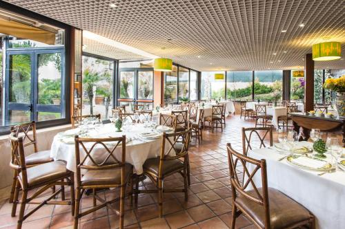 A restaurant or other place to eat at Colleverde Park Hotel