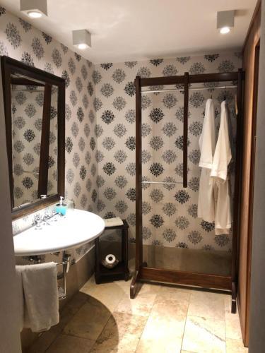 Um banheiro em Cruce´s Hotel Boutique