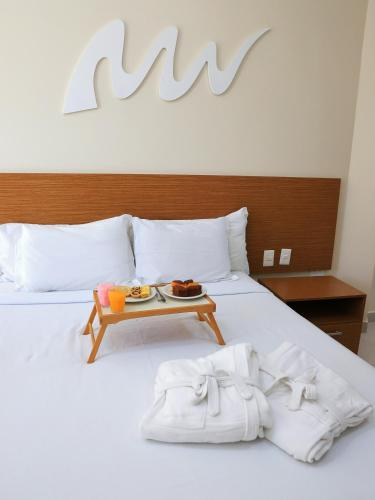 A bed or beds in a room at Real Praia Hotel
