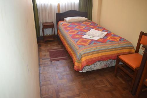 A bed or beds in a room at Hostal Copacabana