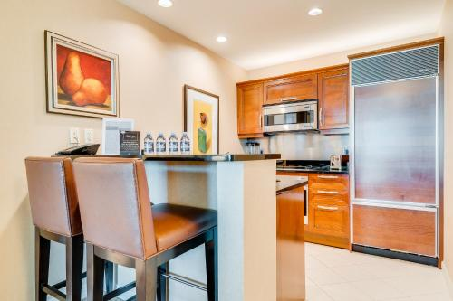 A kitchen or kitchenette at Jet Luxury at The Signature Condo Hotel