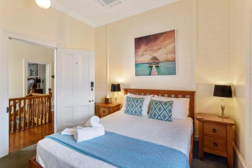 A bed or beds in a room at Riversleigh House