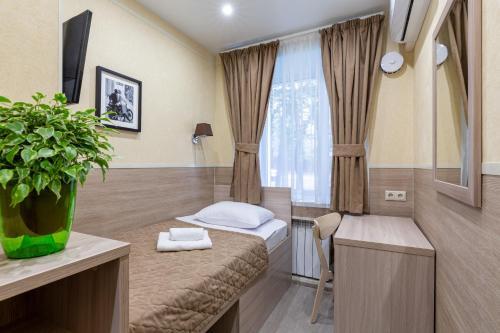 Кровать или кровати в номере Мини-отель Нахимовский