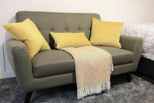 A seating area at Flat 2 Modern Two Bedrooms home with en-suite, free parking and Netflix