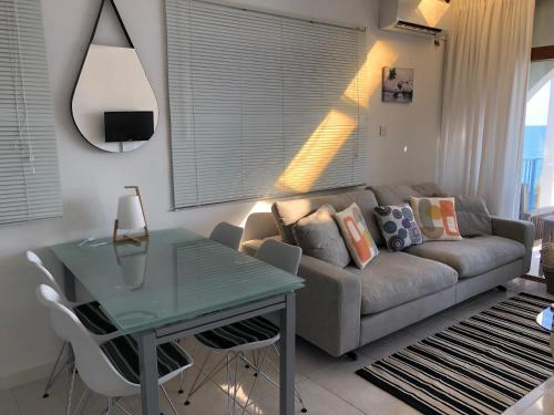 A seating area at Pissouri Beach Front Apartments