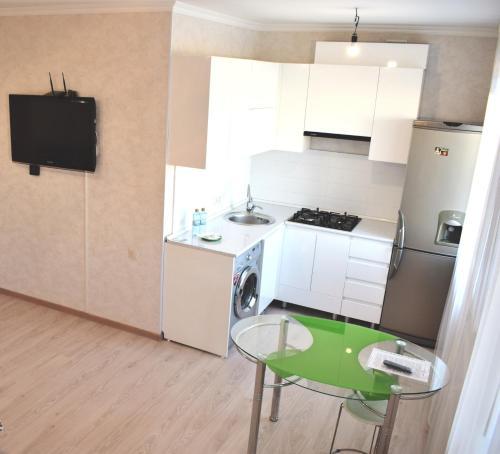 A kitchen or kitchenette at 1 комнатные апартаменты на Абая 138