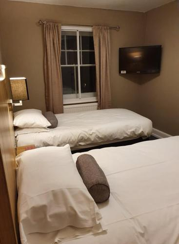 A bed or beds in a room at The Crown Inn Keynsham